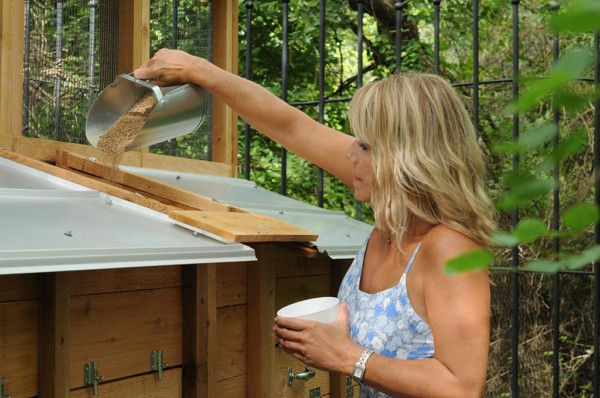 Four feeders are built into the coop accessed from outside and hold ~40 lbs of feed.